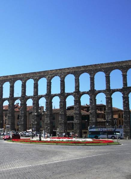 Photograph - Segovia Ancient Roman Aqueduct Iv A Water Conveyance Granite Stone Structure With Arches In Spain by John Shiron