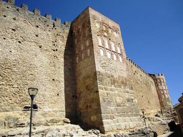 Photograph - Segovia Castle Wall Alcazar Architecture And Design With Street Lamp Posts In Spain by John Shiron