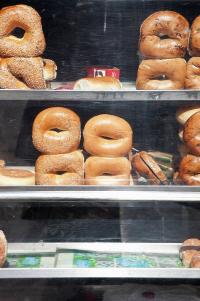 Photograph - Selection Of Bagels On Shelves Behind A Shop Window by Paul Hudson