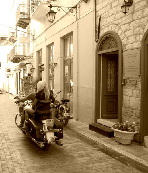 Photograph - Sepia Look Girl Riding Motorcycle Bike Rider Speed Stone Paved Street In Nafplion Greece by John Shiron
