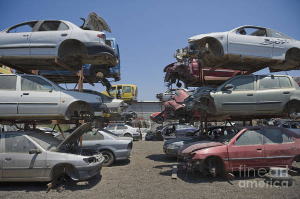 Wrecking Yard Photograph - Shot Of Junkyard Cars by Noam Armonn