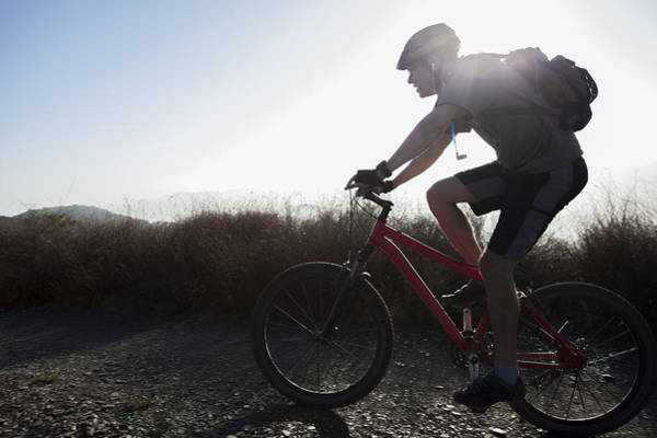 Wall Art - Photograph - Silhoueted Mountain Biker by Mike Raabe