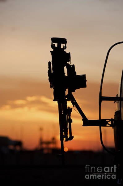 Utility Helicopter Photograph - Silhouette Of A M240g Medium Machine by Terry Moore