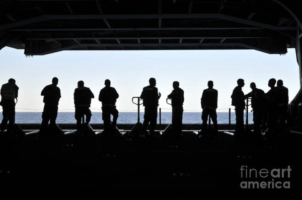 Uss Carl Vinson Photograph - Silhouette Of Sailors Standing by Stocktrek Images