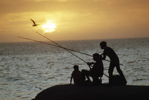 Montevideo Wall Art - Photograph - Silhouetted People Fish by James L. Stanfield