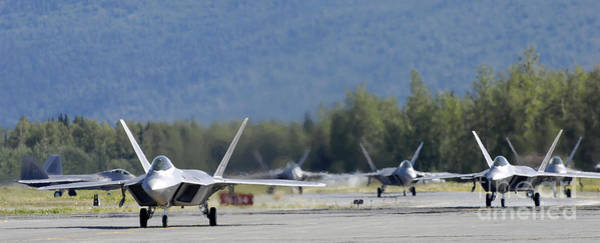 Taxiway Wall Art - Photograph - Six F-22 Raptors Taxi Down The Runway by Stocktrek Images