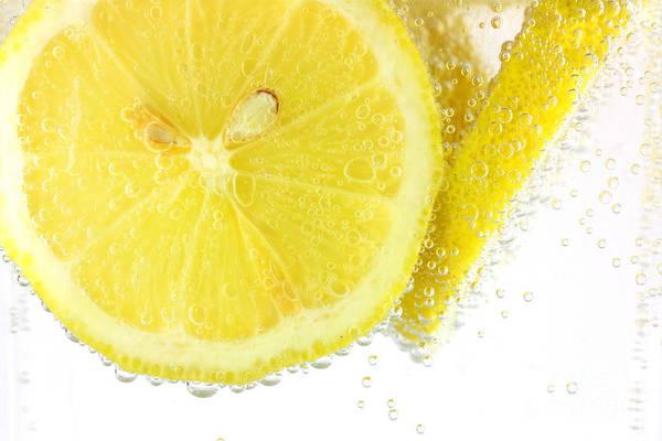 Wall Art - Photograph - Sliced Lemon In Fizzy Water by Simon Bratt Photography LRPS
