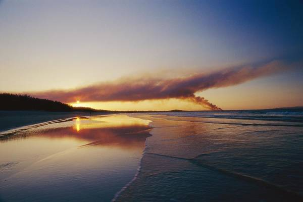 Noosa Wall Art - Photograph - Smoke From A Bush Fire Forms A Large by Jason Edwards