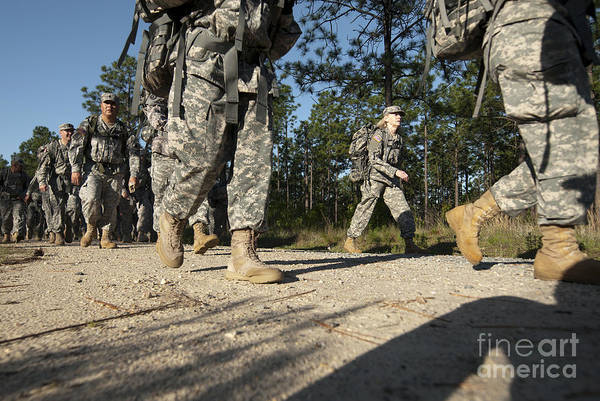 Fort Bragg Wall Art - Photograph - Soldiers Conduct A Ruck March At Fort by Stocktrek Images