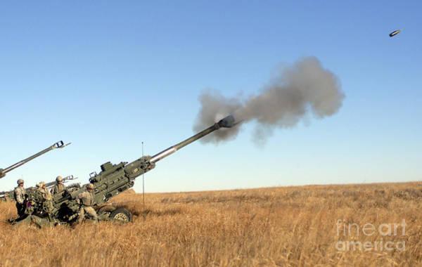 Artillery Brigade Photograph - Soldiers Fire A 155mm M777 Lightweight by Stocktrek Images