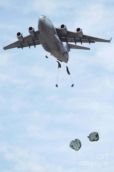 Skydiver Photograph - Soldiers Jump From A C-17 Globemaster by Stocktrek Images