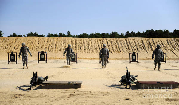 Photograph - Soldiers Marking Their Lanes by Stocktrek Images