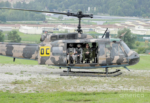 Utility Helicopter Photograph - Soldiers Take Off In A Uh-1 Iroquois by Stocktrek Images