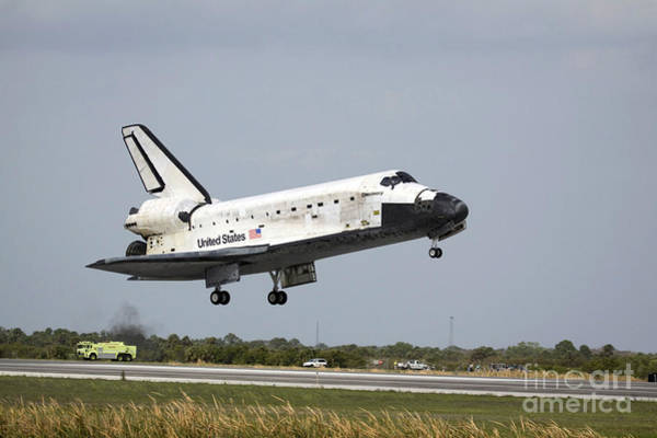 Photograph - Space Shuttle Discovery Approaches by Stocktrek Images