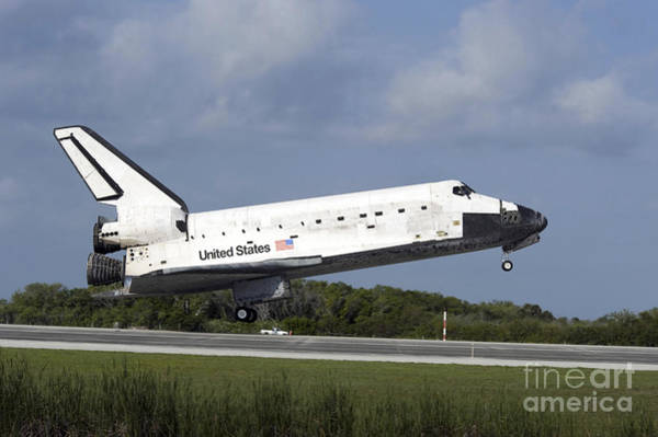 Photograph - Space Shuttle Discovery Lands On Runway by Stocktrek Images