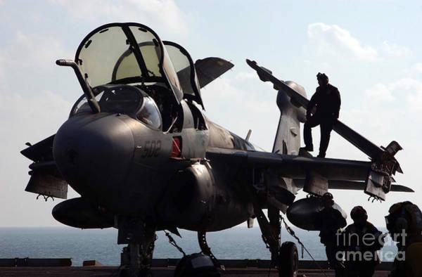 Prowler Photograph - Squadron Personnel Prepare An Ea-6b by Stocktrek Images