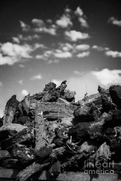 Wall Art - Photograph - Stack Of Peat Turf Gathered Dried In Ireland by Joe Fox