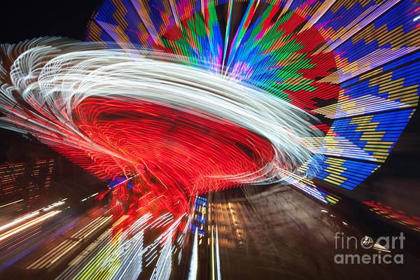 Photograph - State Fair Rides At Night Iv by Clarence Holmes