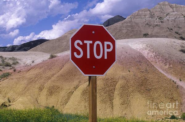 North Dakota Badlands Wall Art - Photograph - Stop Sign In South Dakota Badlands by Will & Deni McIntyre