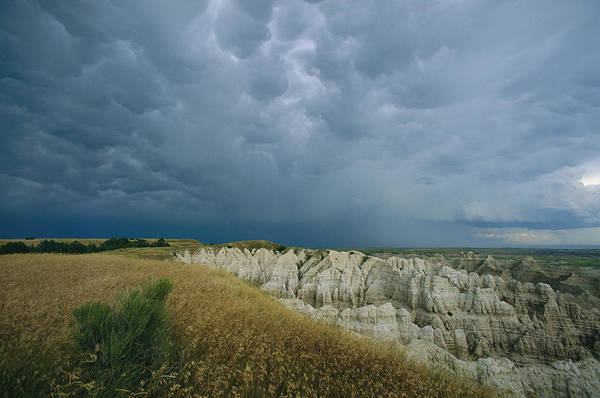 North Dakota Badlands Wall Art - Photograph - Storm Clouds Gather Over The Southern by Annie Griffiths