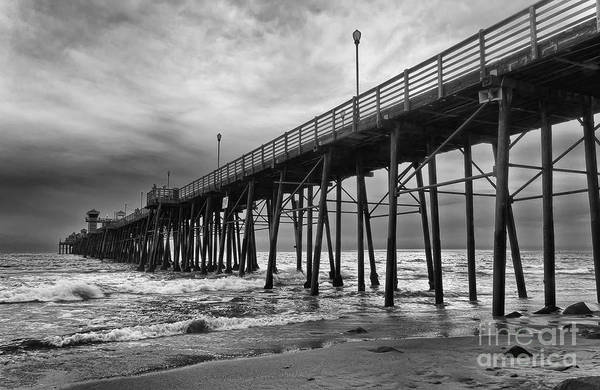 Photograph - Storm Clouds Over The Pier by Eddie Yerkish