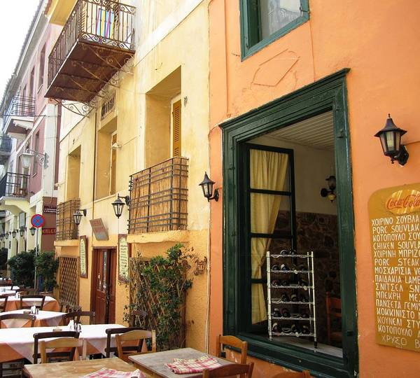 Photograph - Street Cafe Greek Restaurant In Nafplion Greece by John Shiron