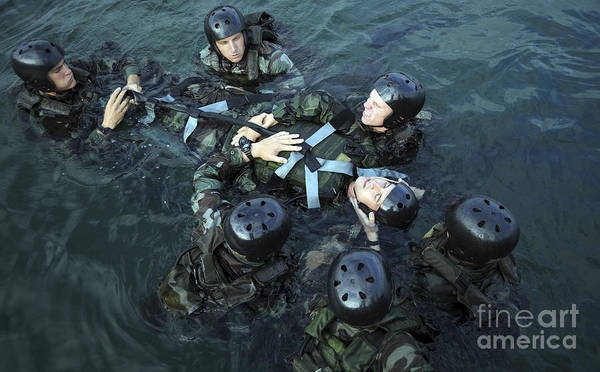 Navy Seal Photograph - Students Secure A Simulated Casualty by Stocktrek Images