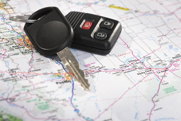 Road Map Photograph - Studio Shot Of Car Key On Map by Vstock LLC