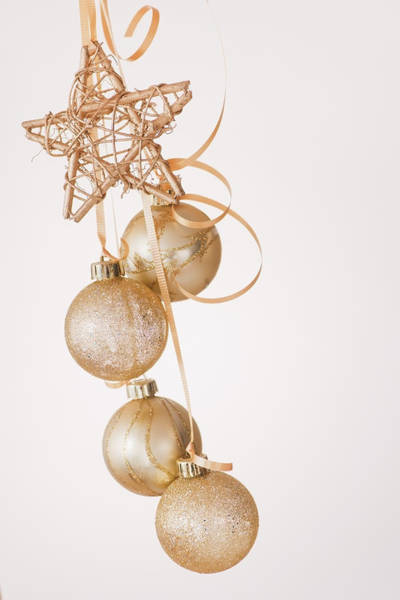 Christmas Photograph - Studio Shot Of Gold Christmas Ornaments by Daniel Grill