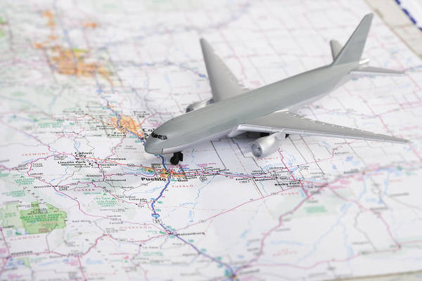 Road Map Photograph - Studio Shot Of Toy Airplane On Map by Vstock LLC