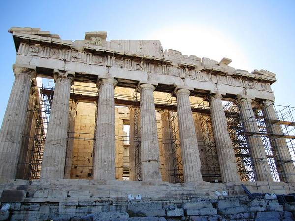 Photograph - Stunning Acropolis Parthenon Architectural Pillars With Sun Rising And Blue Sky In Athens Greece by John Shiron