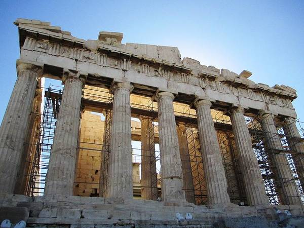Photograph - Stunning Acropolis Parthenon Architectural Pillars With Sun Rising II And Blue Sky In Athens Greece by John Shiron