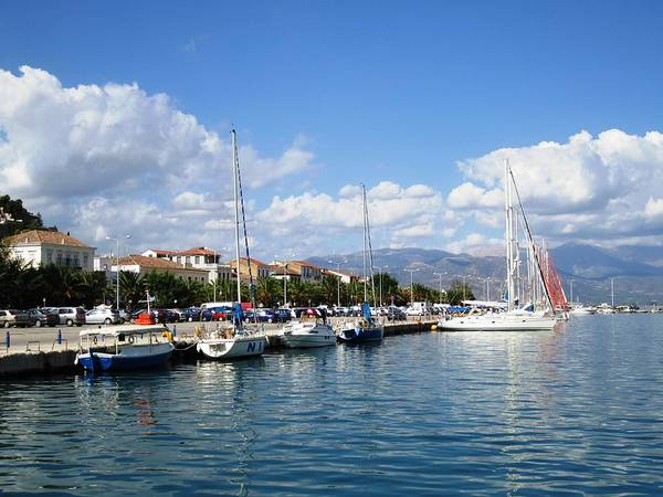 Photograph - Stunning Nafplion Bay Water Reflection And Sailing Boats by John Shiron