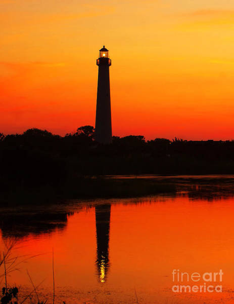 Photograph - Sunset Lighthouse Reflection by Nick Zelinsky