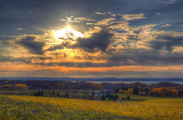 Traverse City Photograph - Sunset Over The Bay by Twenty Two North Photography