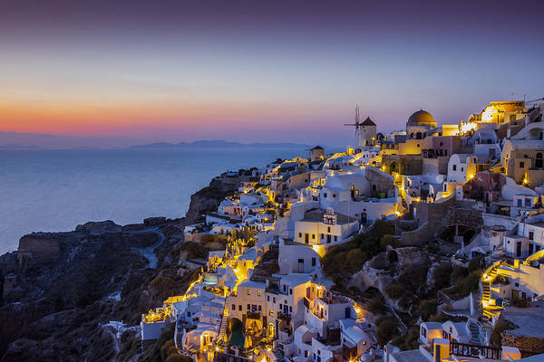 Wall Art - Photograph - Sunset Over The Town Of Oia Which by Paul Phillips