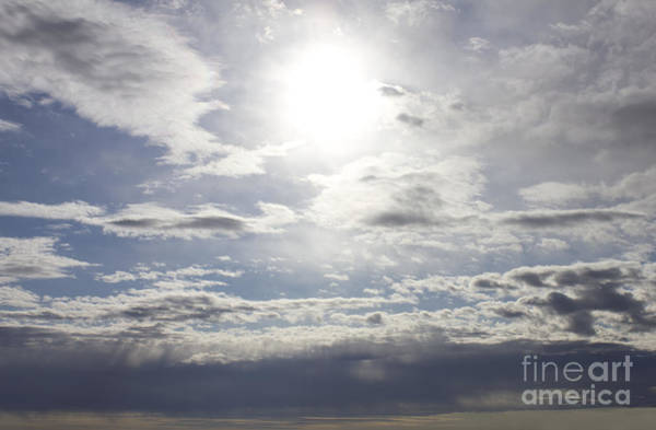 Photograph - Sunspot Clouds by Donna L Munro