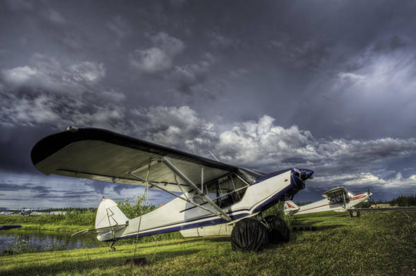 Payers Wall Art - Photograph - Super Cub Under A Stormy Sky by Thomas Payer