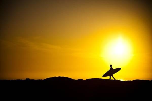 Sunrise Beach Photograph - Surfer's Dawn by Zarija Pavikevik