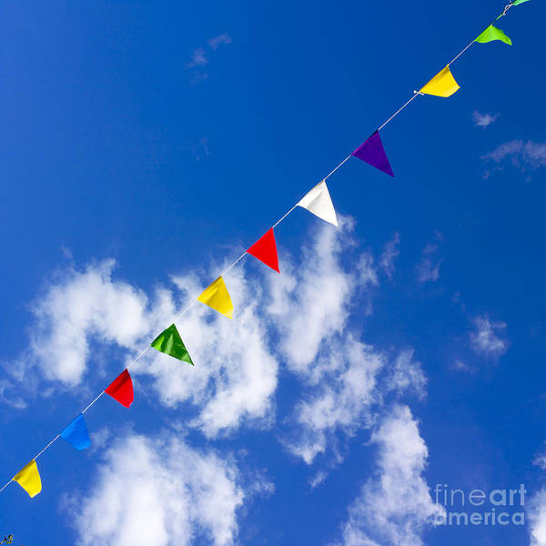 Adorn Photograph - Suspended Festive Flags. by Bernard Jaubert