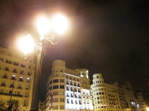 Photograph - Tall Lamp Post Brightens Up The Streets Of Valencia In A Foggy Summer Night In Spain by John Shiron