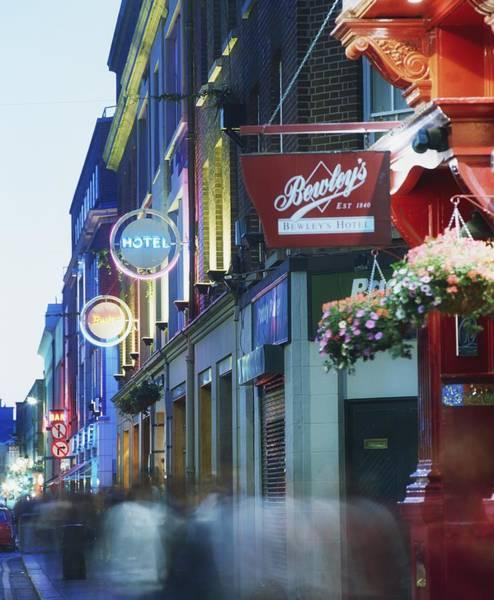 Walking In The Rain Wall Art - Photograph - Temple Bar, Dublin, Co Dublin, Ireland by The Irish Image Collection