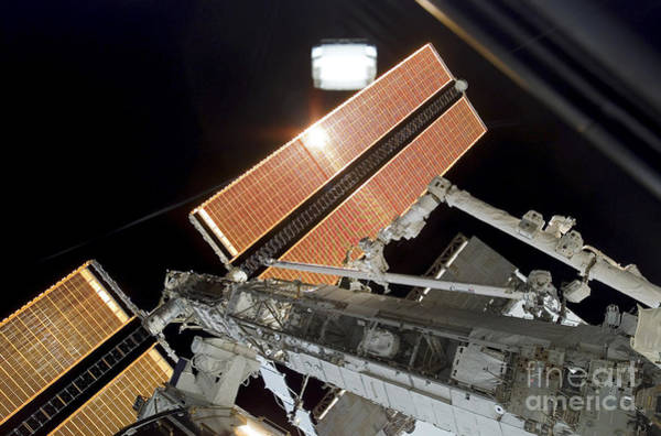 Photograph - The Canadarm2 Completes The Handoff by Stocktrek Images