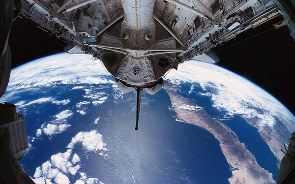 Wall Art - Photograph - The Earth Viewed From The Space Shuttle by Stockbyte
