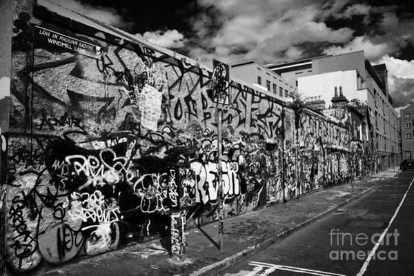 Wall Art - Photograph - the famous U2 wall covered in fan grafitti at windmill lane studios in dublin republic of ireland by Joe Fox