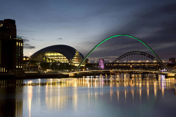 Gateshead Millennium Bridge Photograph - The Millennium Bridge And Gateshead Quays At Night by Roger Coulam