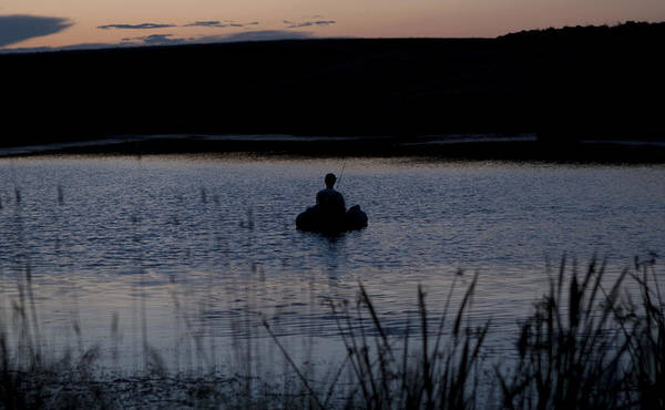 Photograph - The Night Fisherman Floats by Lorraine Devon Wilke