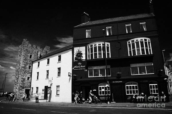 Wall Art - Photograph - The Old Tower House Housing Bangor Tourist Information Centre Beside The Black Boat Pub County Down by Joe Fox