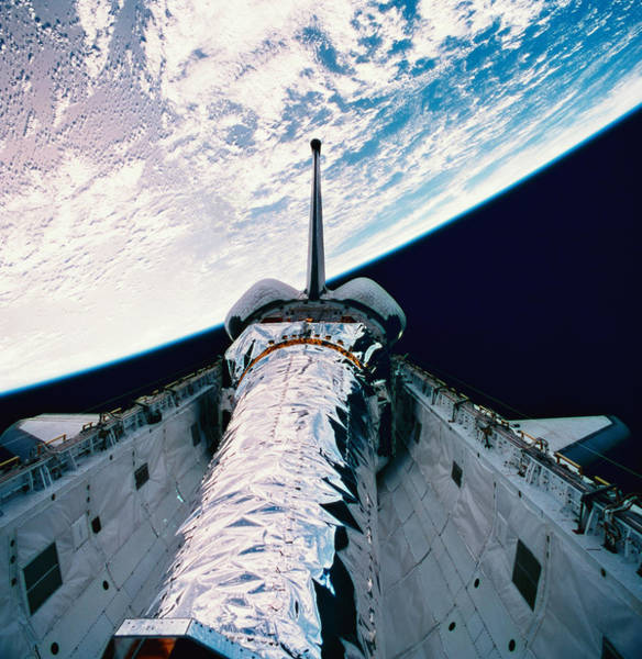 Skill Photograph - The Space Shuttle With Its Open Cargo Bay Orbiting Above The Earth by Stockbyte