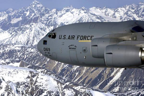 C-17 Photograph - The Spirit Of Denali Flies by Stocktrek Images